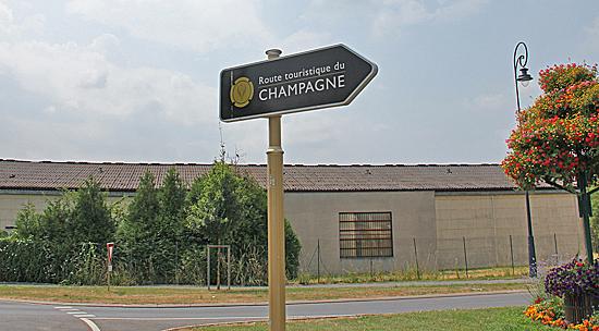 Champagne-skylt