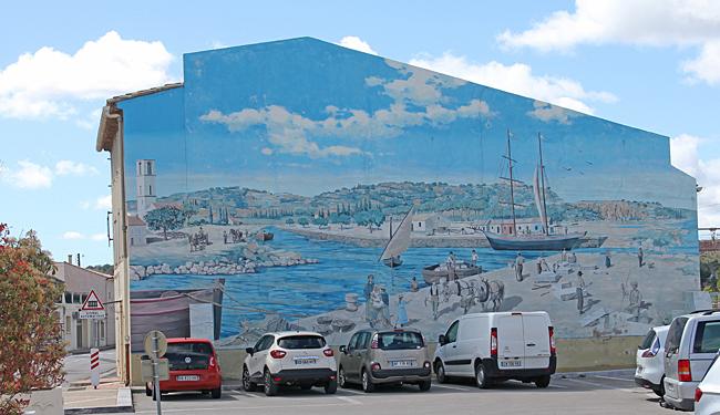 Väggmålning som visar en del av hamnen förr.
